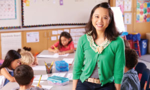 Female teacher standing in front of a class of kids