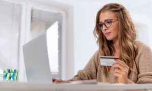 Female teacher making an online purchase