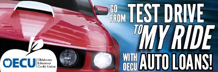 Go from test drive to my drive with OECU auto loans with a picture of a red car on the side.